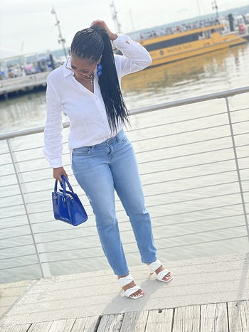 reviewer wearing the heels in white