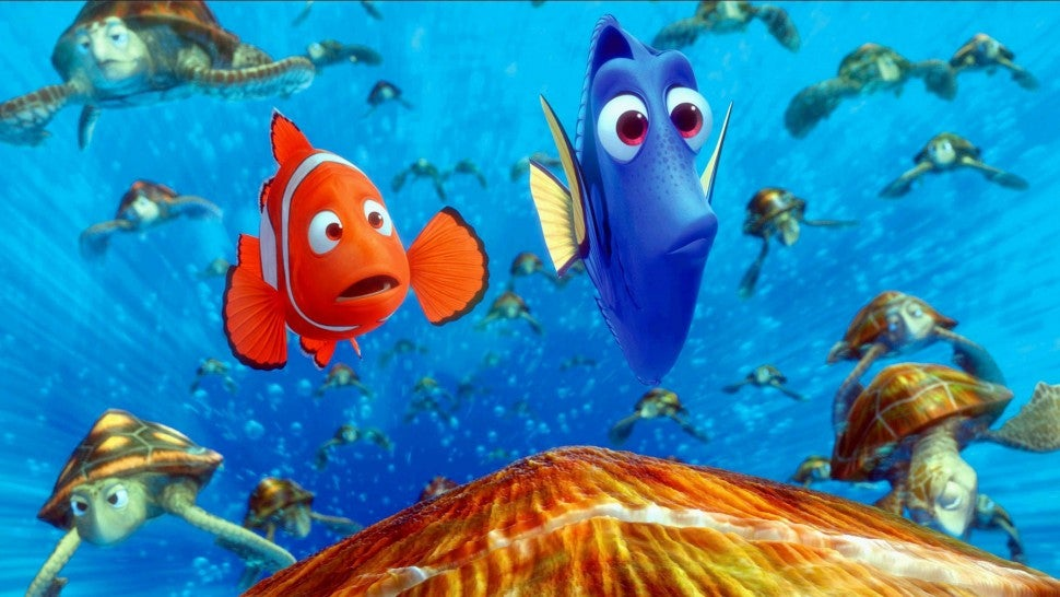 Marlin and Dory are surrounded by a group of sea turtles