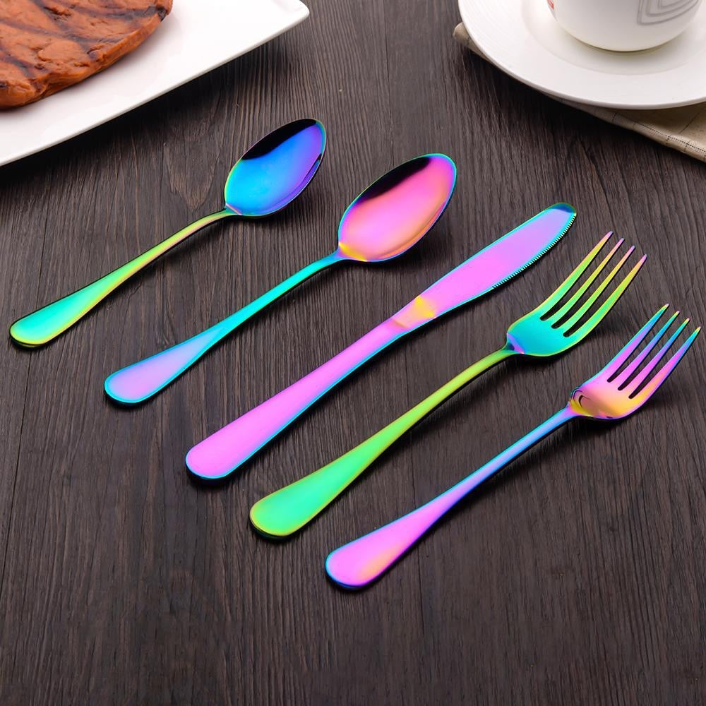 two spoons, a knife, and two forks on a table