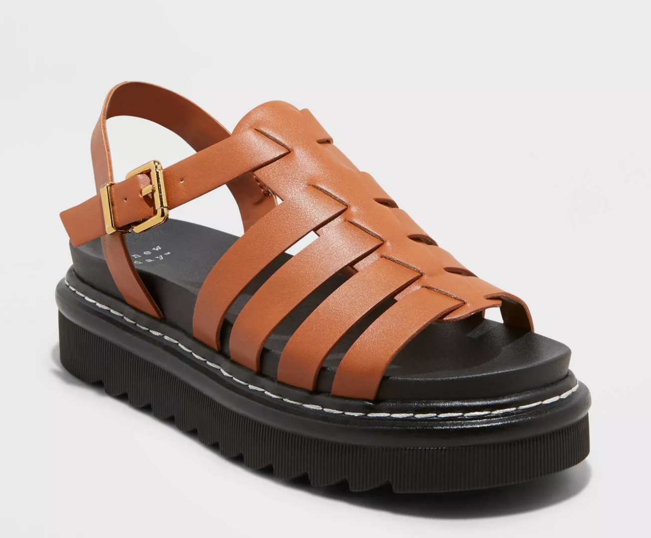 tan sandals with a chunky black platform sole