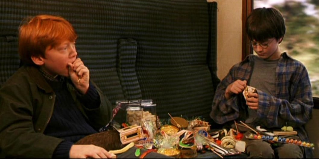 Harry and Ron eat different candies on the train