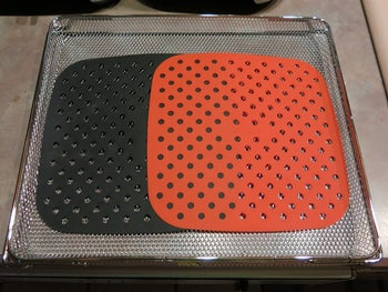 Black and red square liners with ventilation holes in them