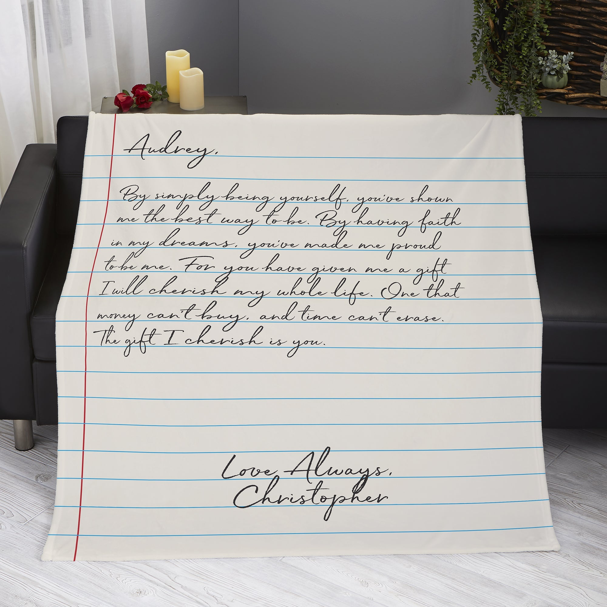 the blanket printed to look like notebook paper with a love letter written on it
