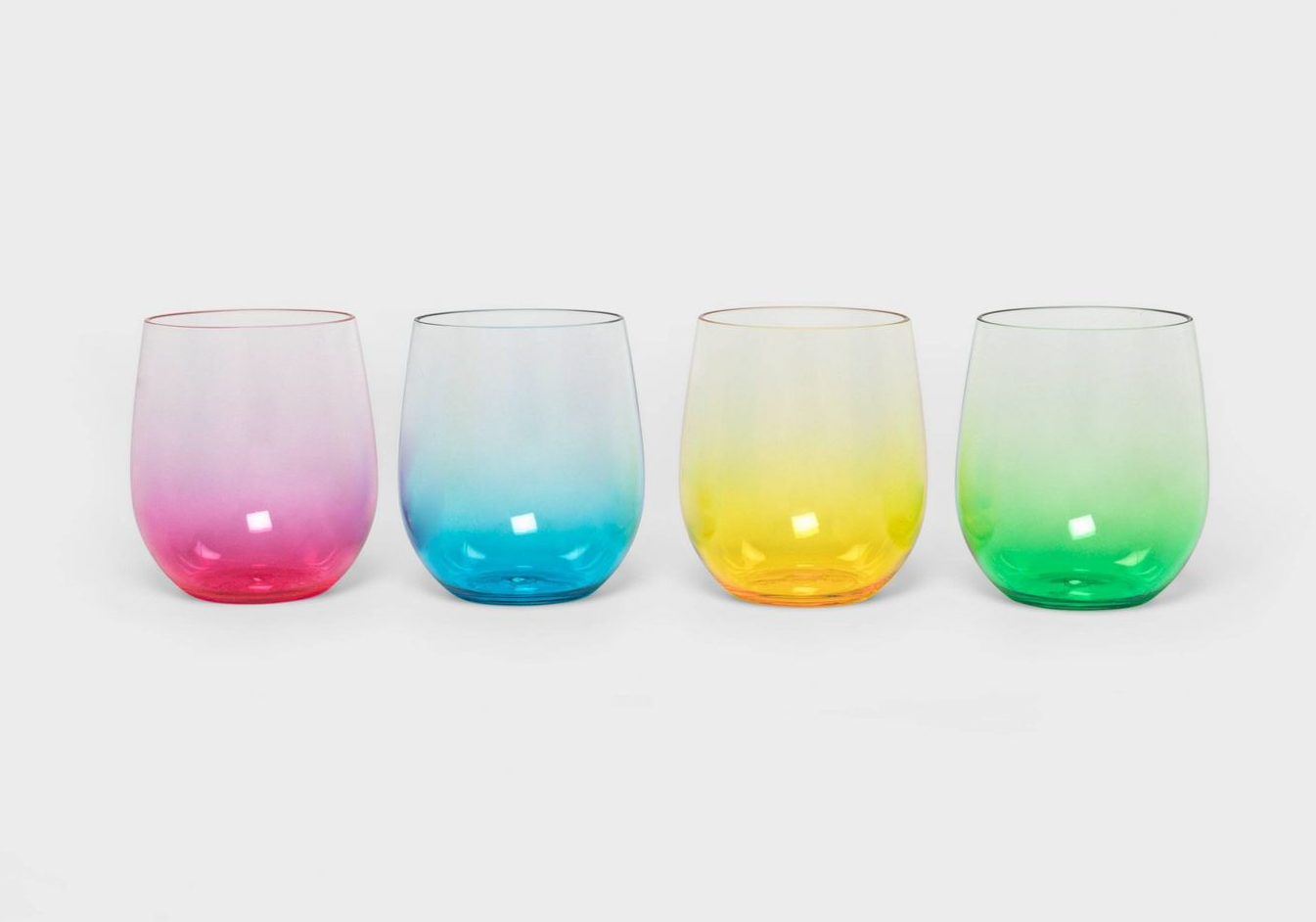 four ombre wine glasses in red, blue, yellow, and green