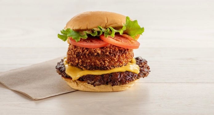 A cheeseburger topped with a mushroom burger