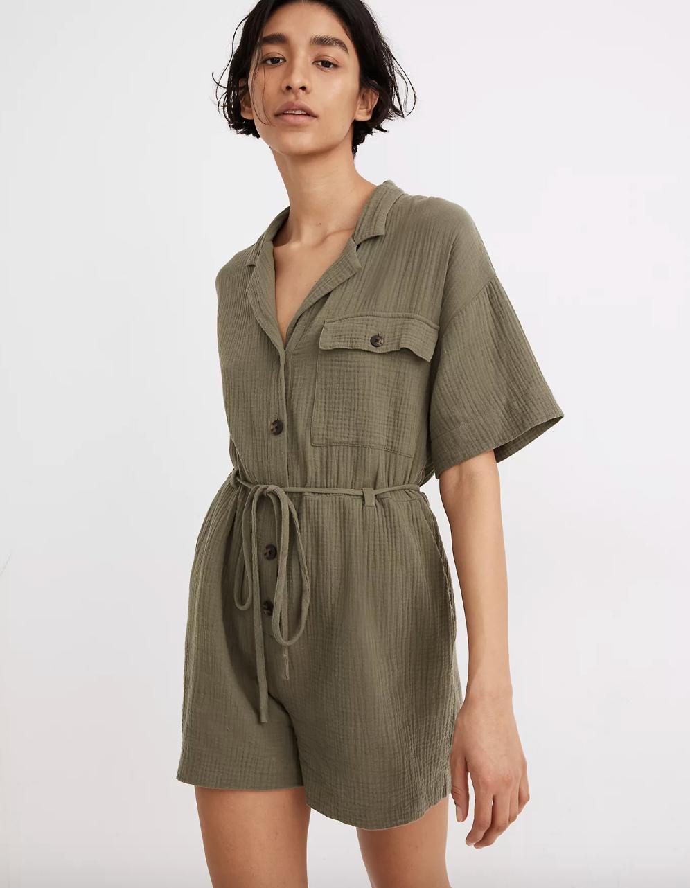model wearing the green romper