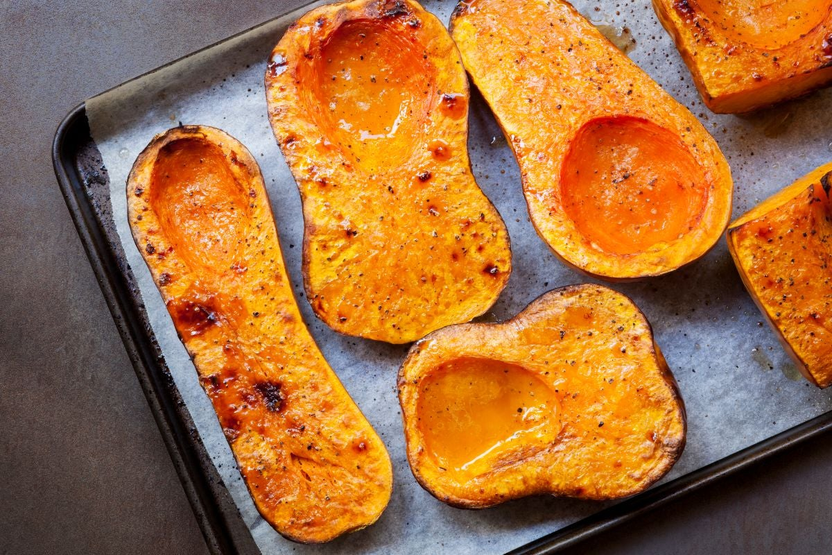 Roasted butternut squash on a baking tray lined with parchment paper