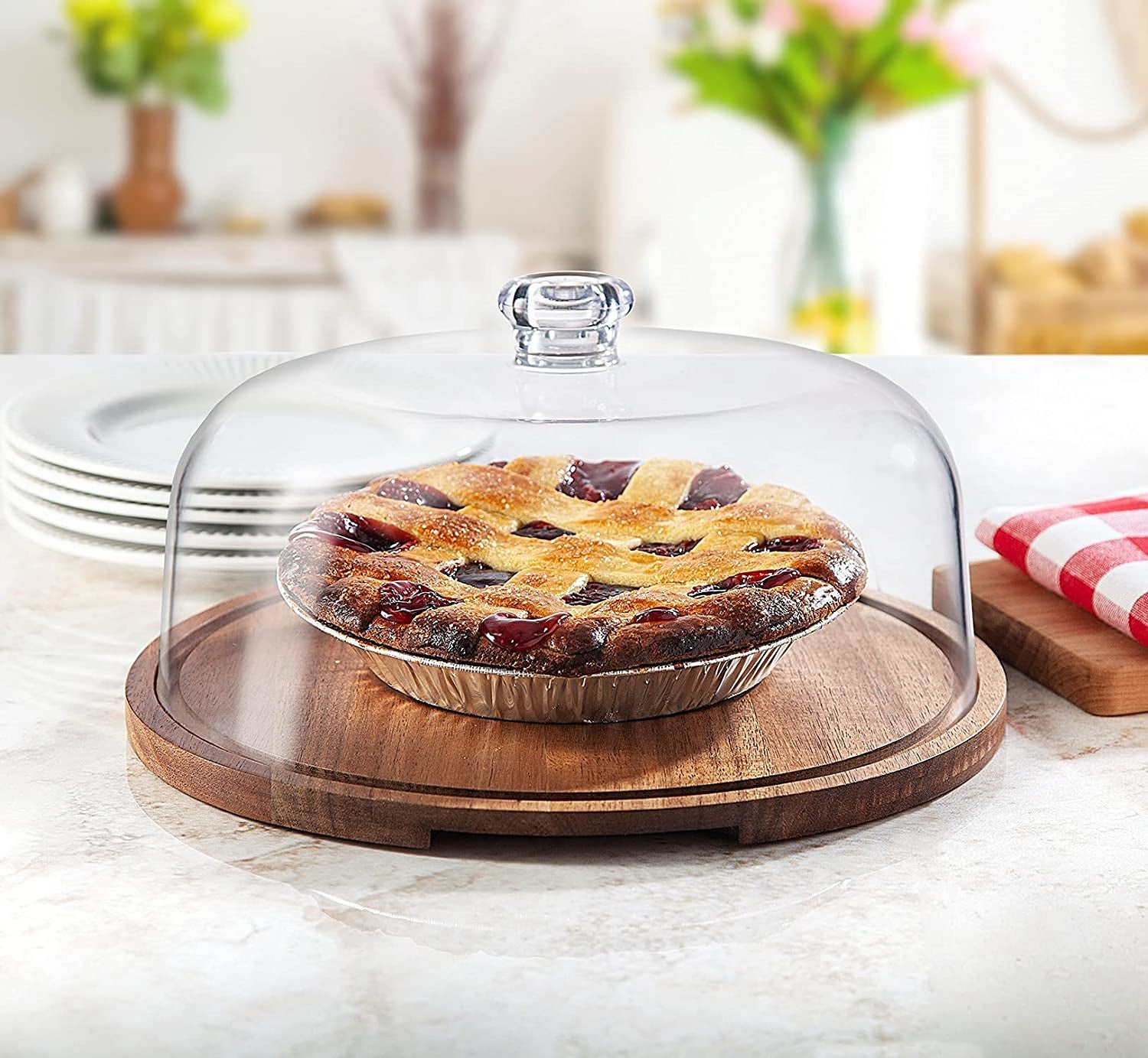 the glass and wood stand with a pie underneath
