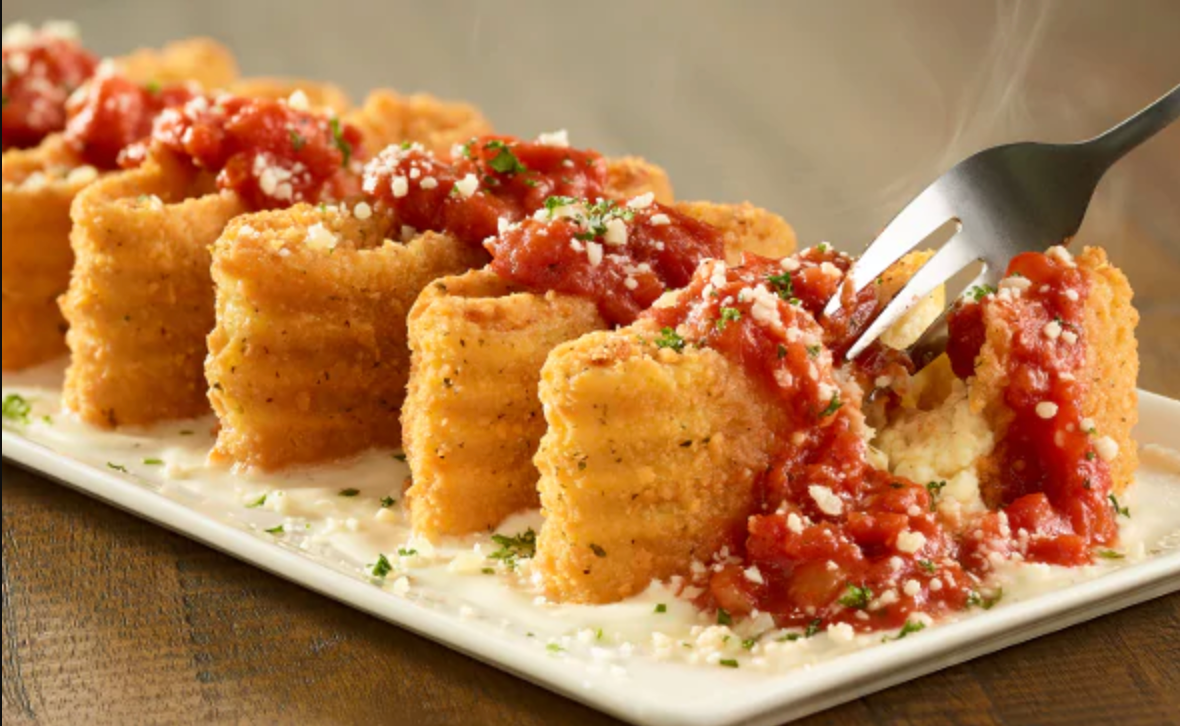 Fried lasagna noodles covered in tomato sauce