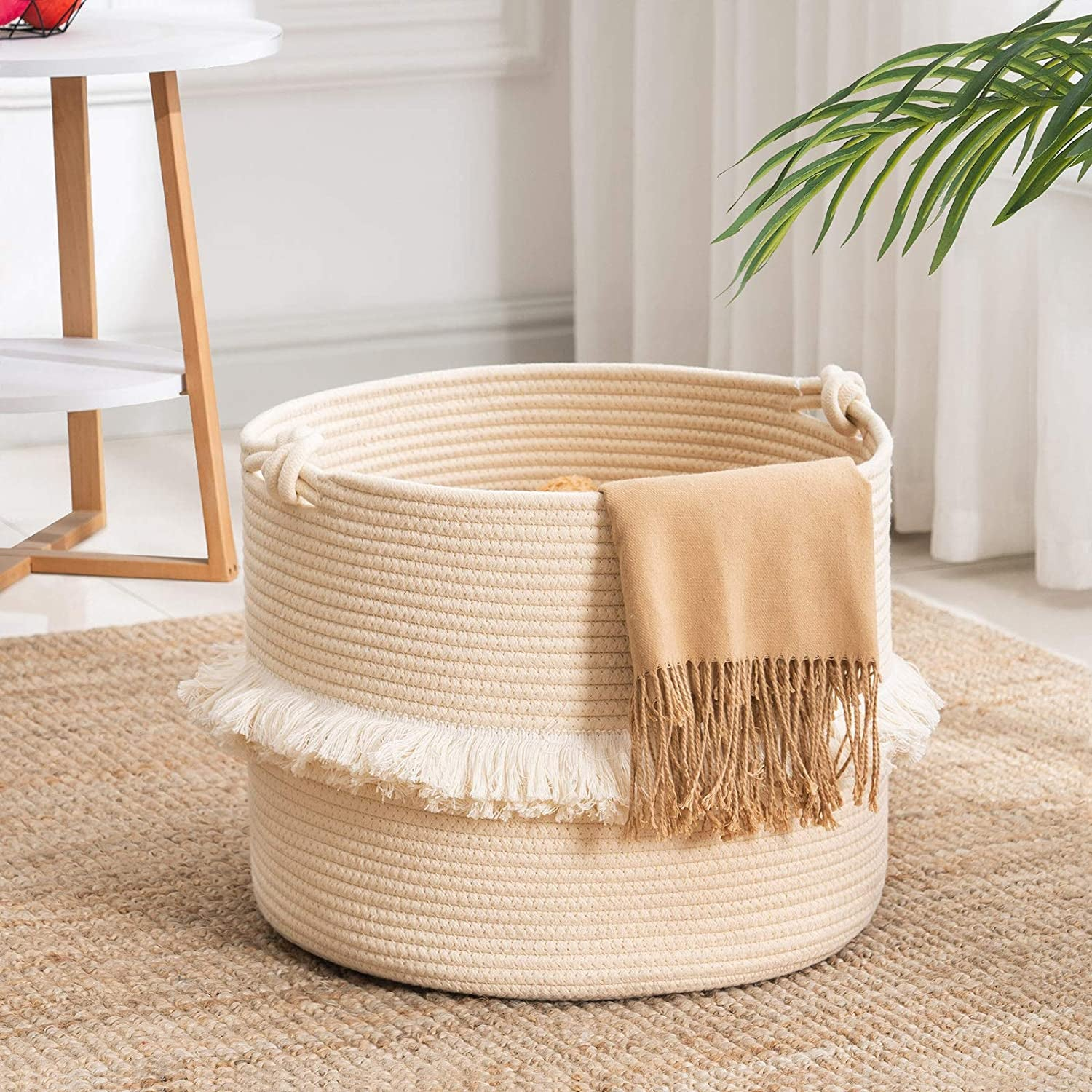 the taupe basket with a blanket hanging off the side