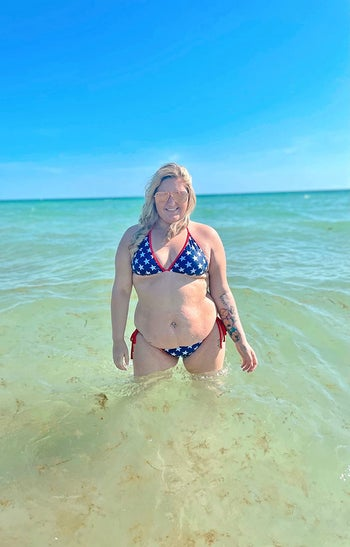 A reviewer in the flag print bikini