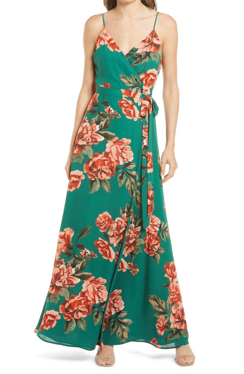model in green maxi with large pink rose print