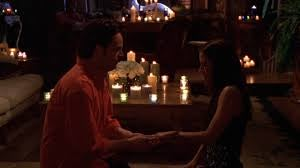 Chandler proposes to Monica in a dark room