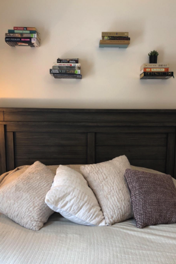Reviewer photo of the shelves above a bed
