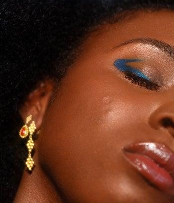 model wearing a teal blue eyeshadow