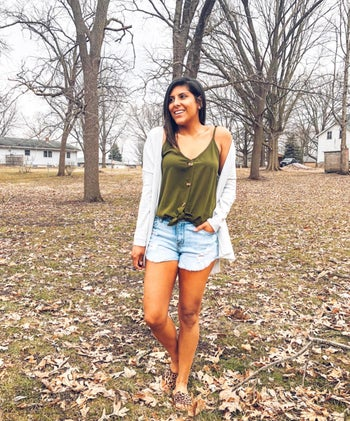 another reviewer wearing the olive version with denim shorts and a cardigan