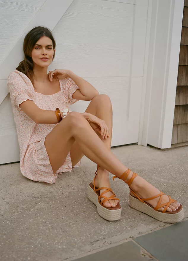 model wearing platform sandals with wrap-up style and criss-cross straps