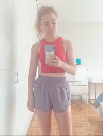 BuzzFeed editor in high waist elastic purple shorts