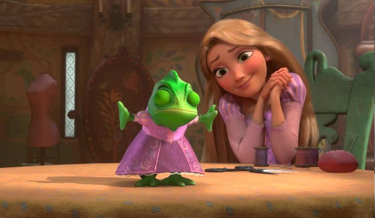 Rapunzel admires Pascal's dress