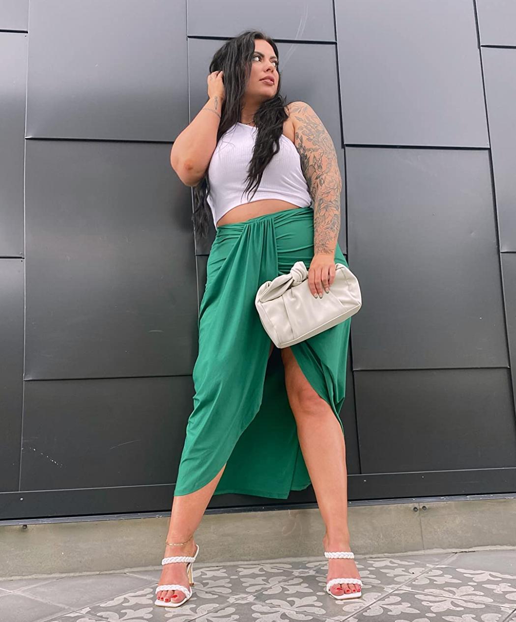 reviewer wearing the green skirt
