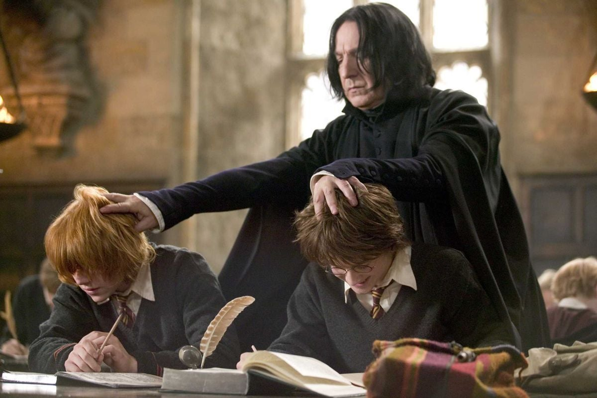 Snape forces Harry and Ron to read their textbooks