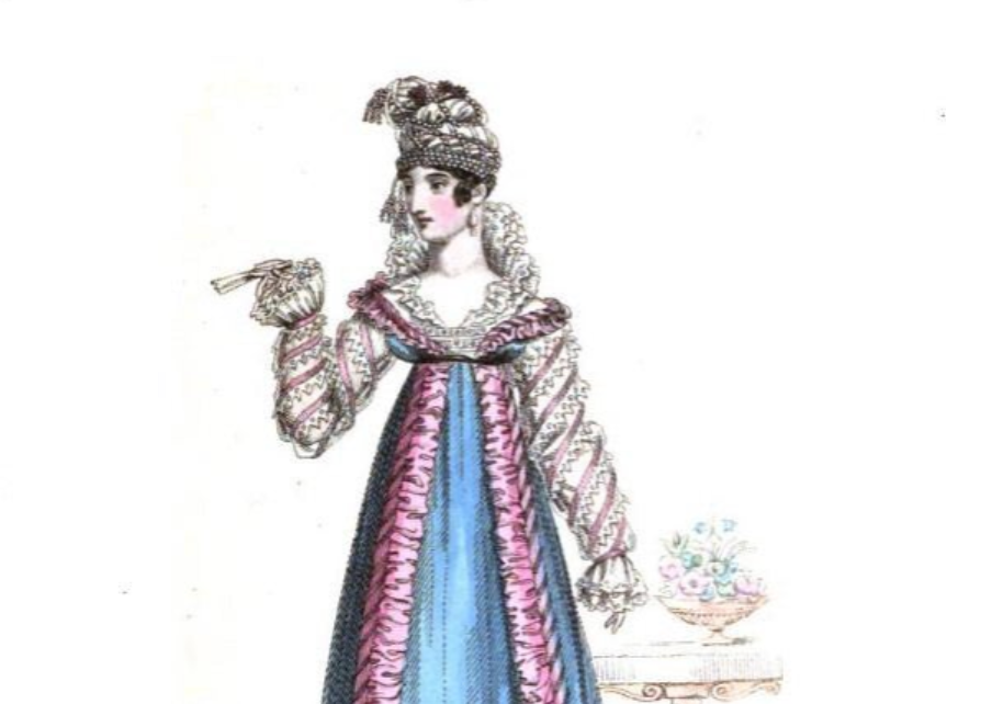 A woman wears her hair up underneath a cloth wrap adorned with flowers. On her body she wears a long-sleeved puffy dress with long drapes in the front