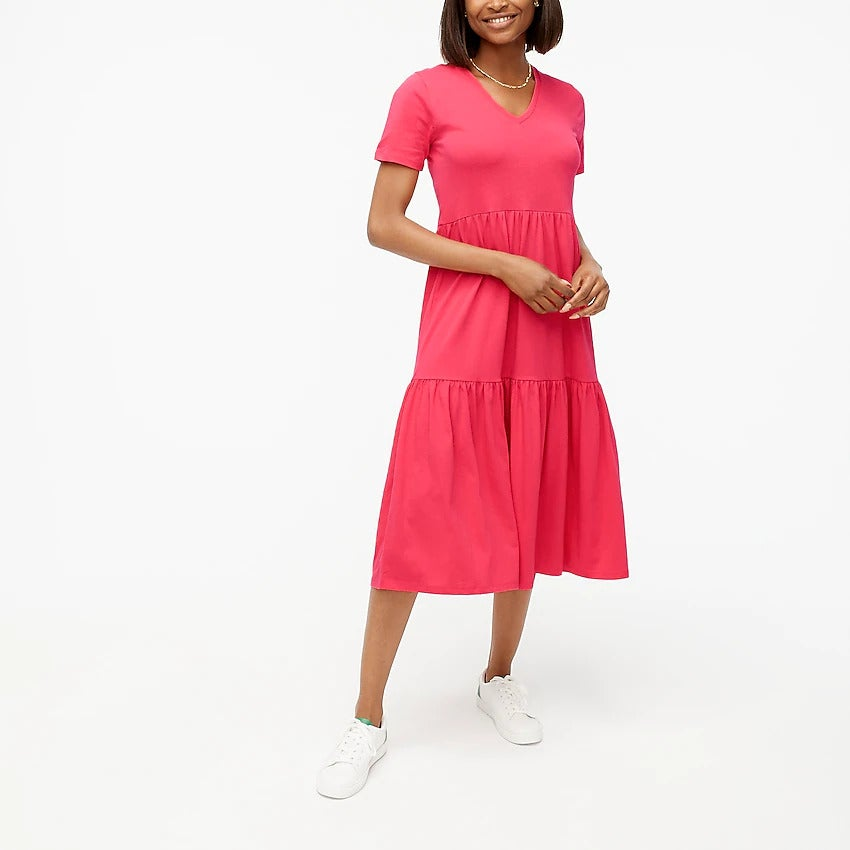 model wearing the bright coral dress with white sneakers
