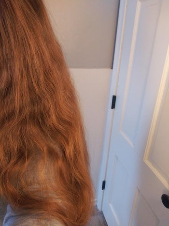 Reviewer with frizzy long hair