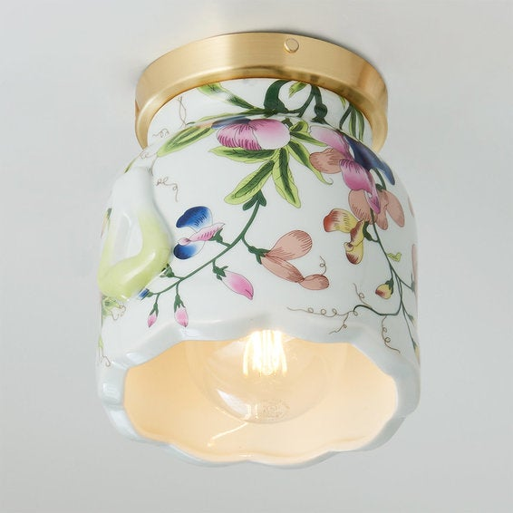 the white ceramic sconce with a floral pattern