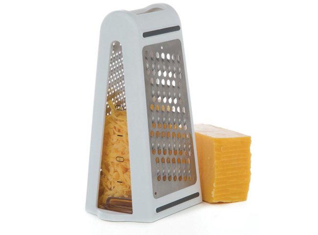 A grater with cheese in the middle and slices on the side