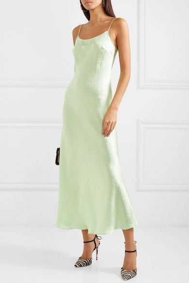 A long, simple dress with spaghetti straps