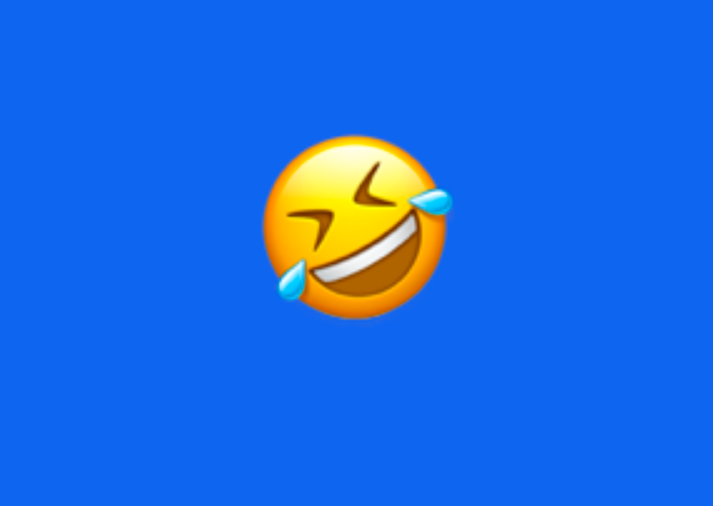 An emoji turned on its side with tears coming out of its eyes as it laughs