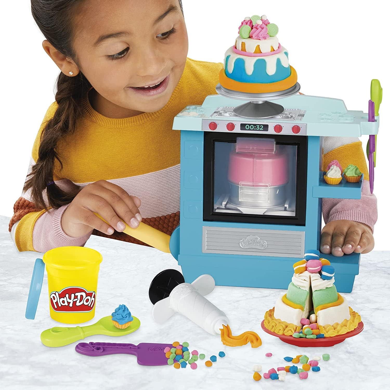 Child model playing with Play-Doh bakery set