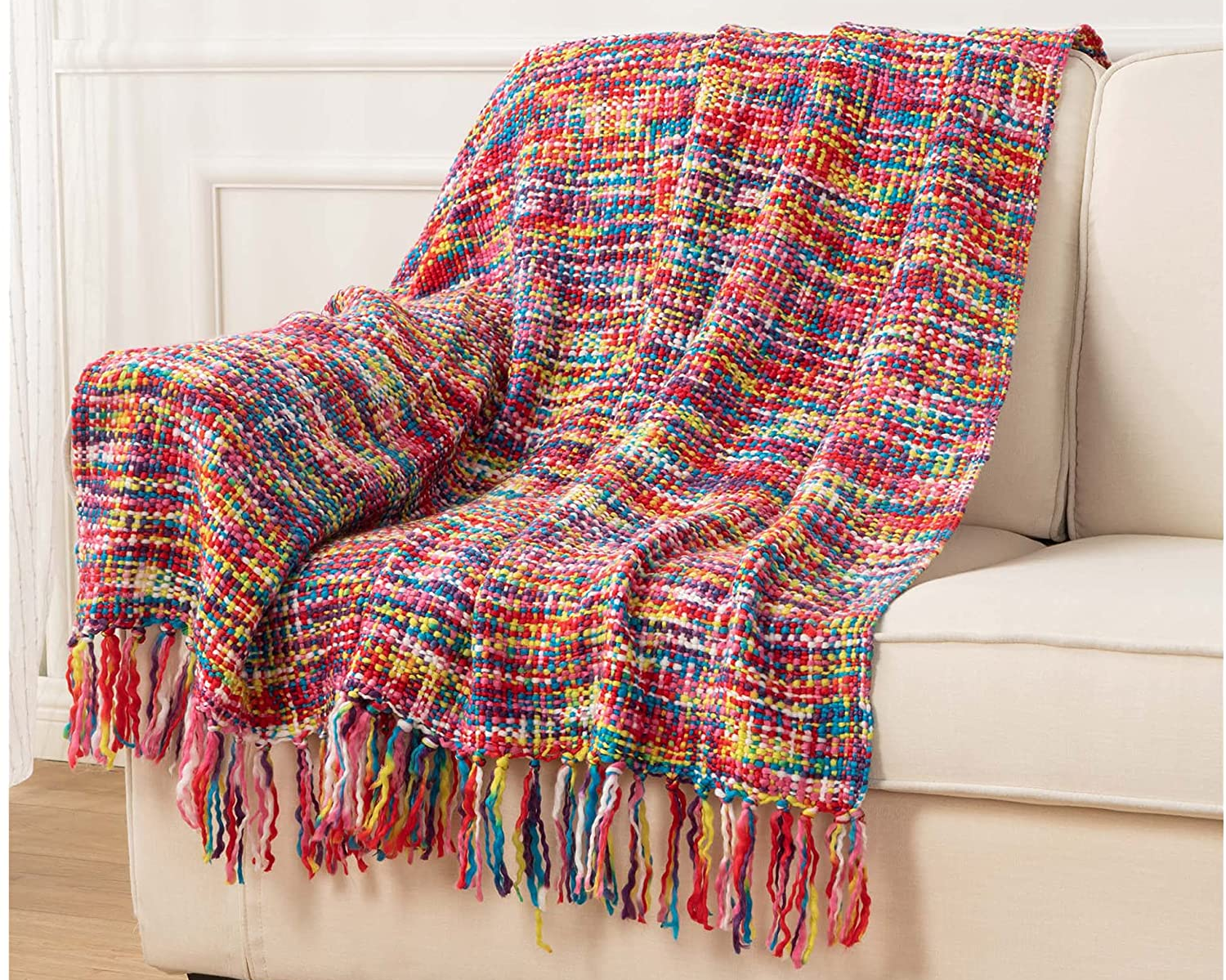 the rainbow blanket draped over a couch