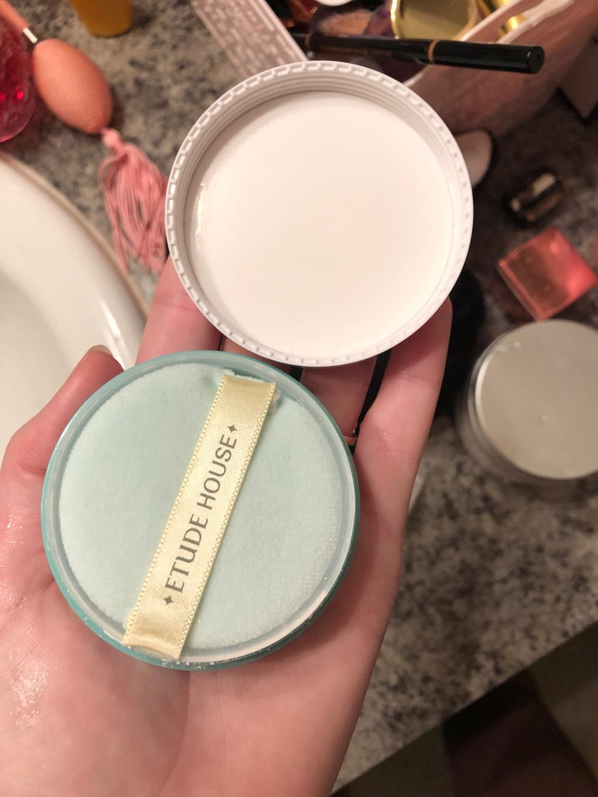a reviewer holding the powder product