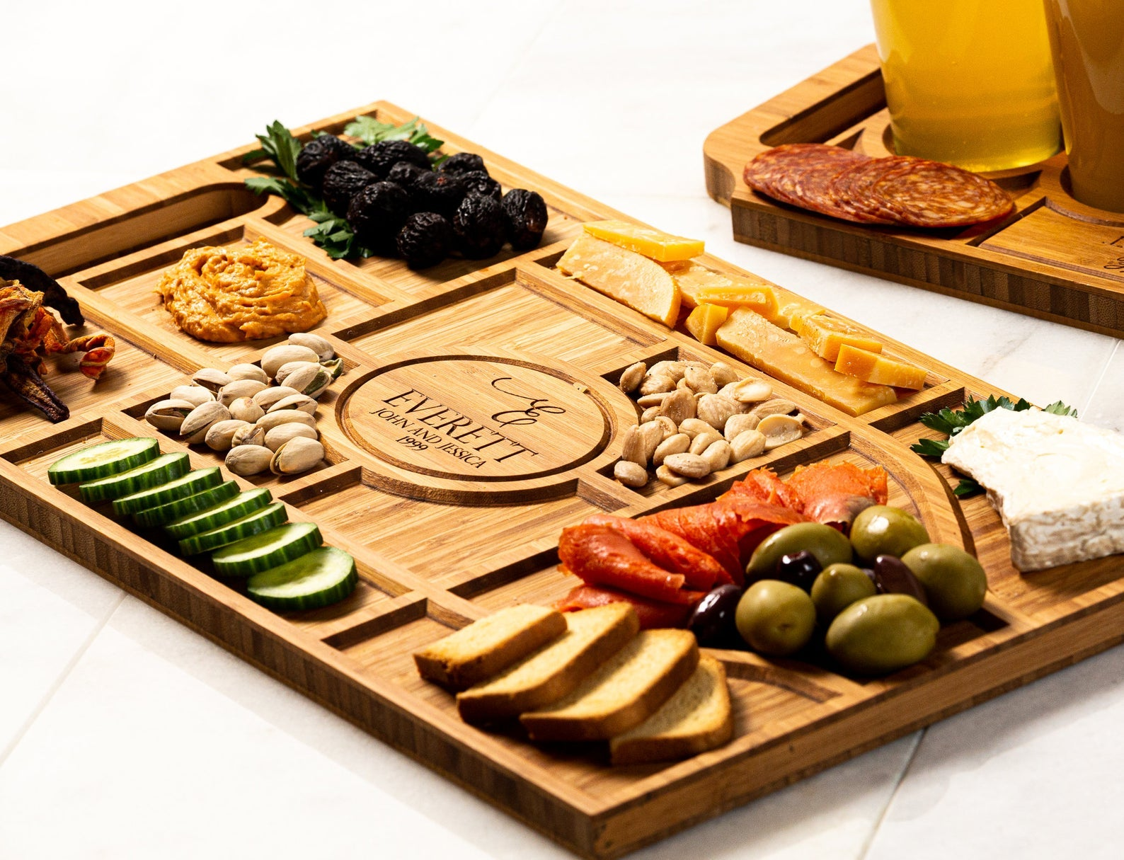 an assortment of nuts and cheese on a personalized charcuterie board