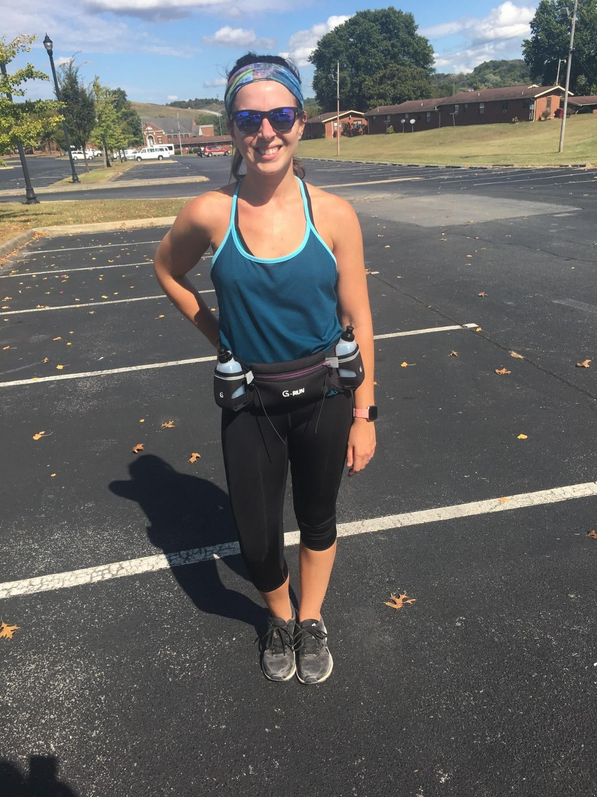 Reviewer wears black hydration belt while training for a marathon