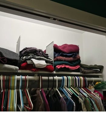 reviewer's closet with stacks of sweaters in between the dividers