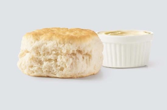 A biscuit with a side of honey butter