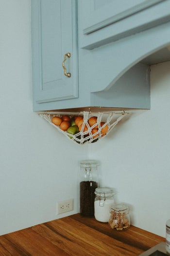 the fruit hammock under a cabinet