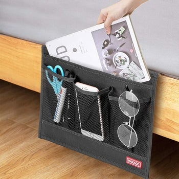 Model placing magazine in bedside caddy