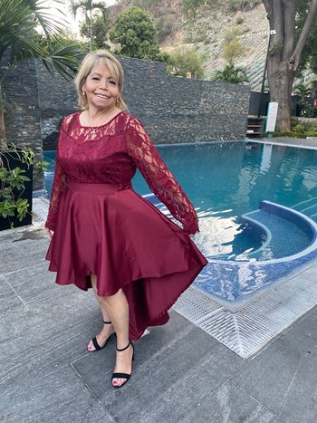 reviewer wearing the burgundy version with black heels