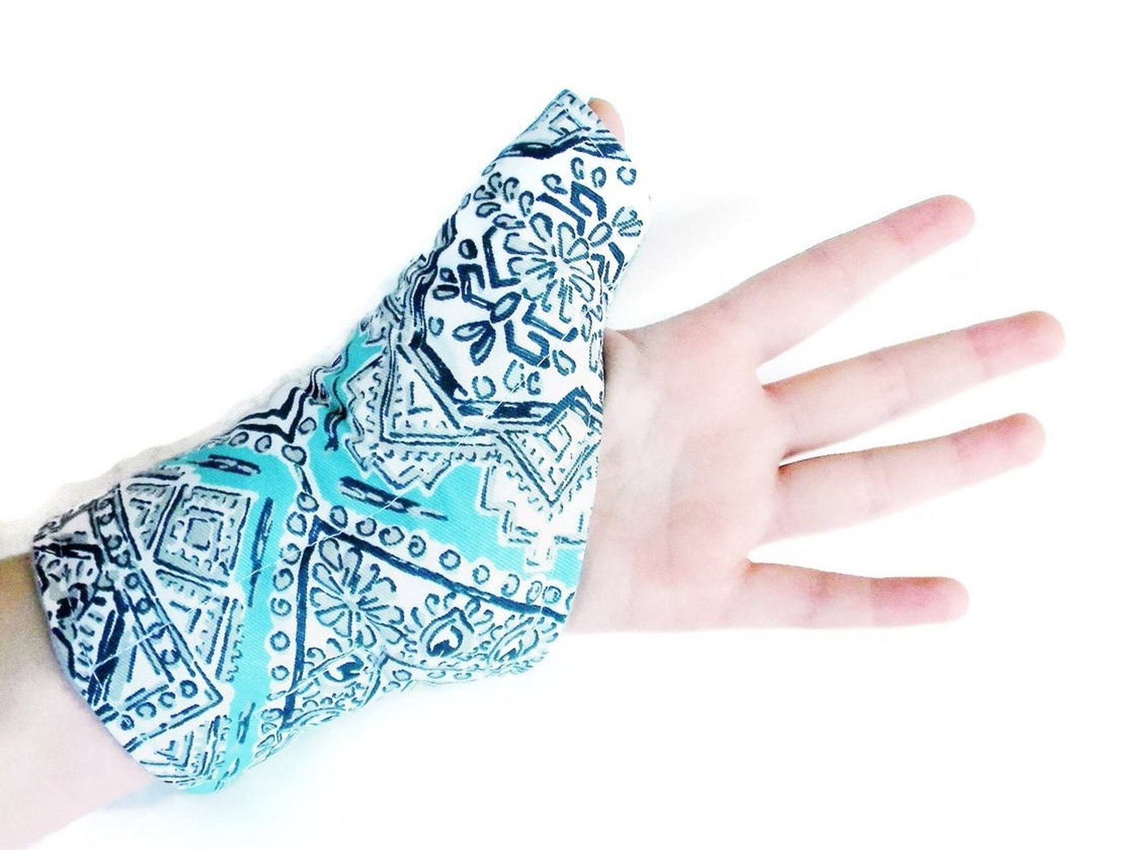 Model wearing blue pack that covers the bottom of their hand, wrist, and thumb