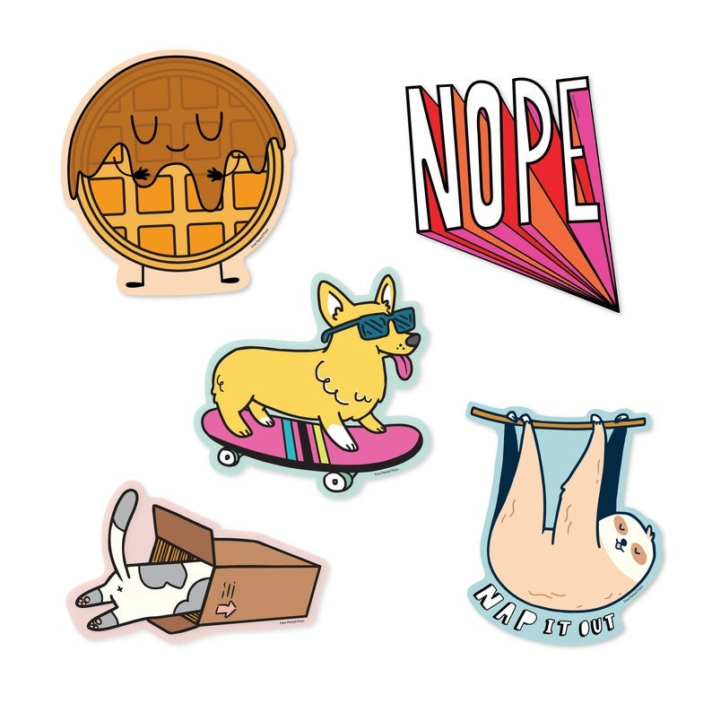 five stickers: a smiling waffle covered in syrup, a corgi wearing sunglasses on a skateboard, a cat butt sticking out of a box, block letters reading