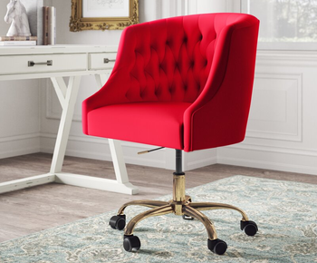 the chair in red sitting in front of a desk