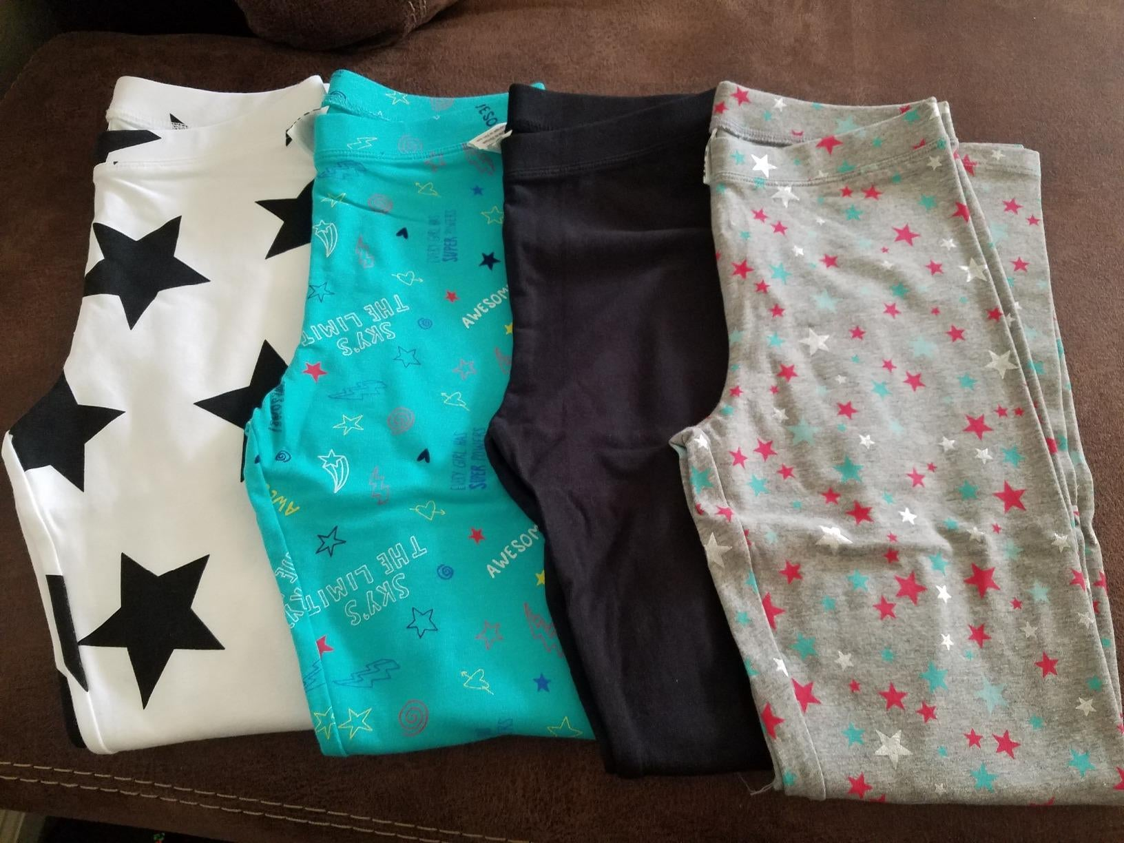 four pairs of leggings with different star designs on them