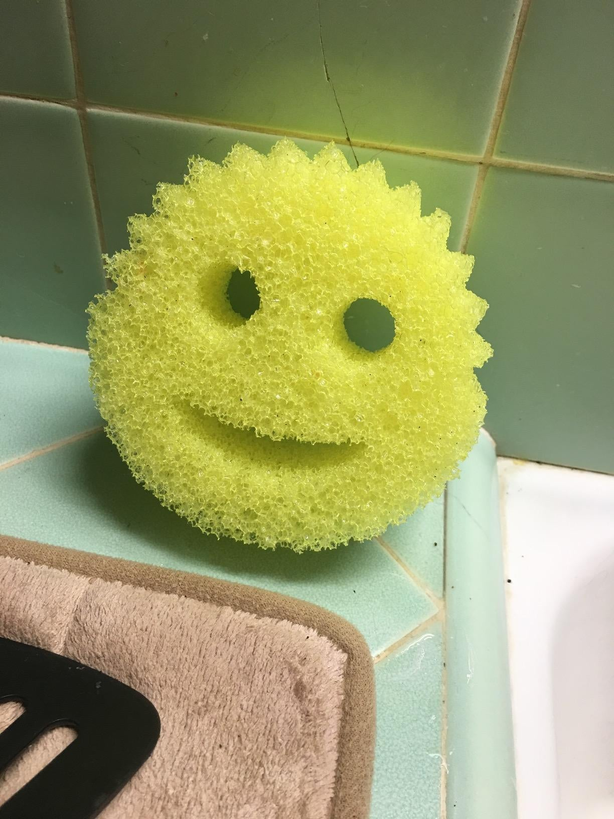 a yellow sponge that looks like a smiley face