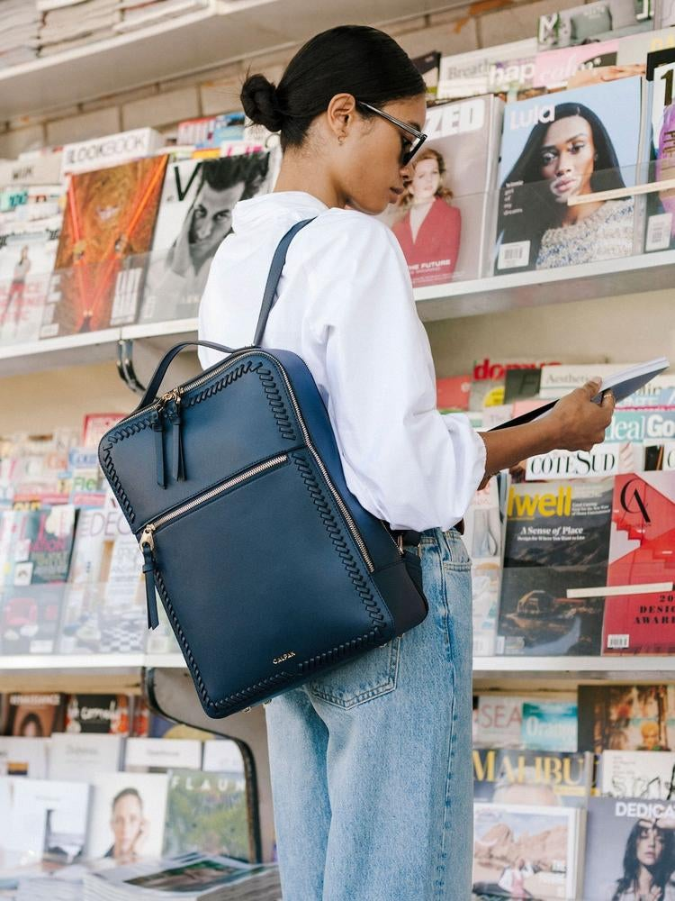 model wearing the navy blue backpack