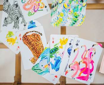 the cards featuring leopards, flamingos, frogs, birds, and snakes and with a tropical bird print on the back