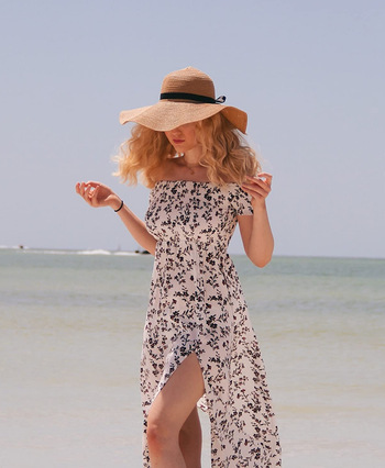 reviewer wearing the dress in white with black flowers